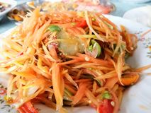 Papaya salad. SOM-TAM Thai delicious raw papaya salad with unique taste hot and spicy royalty free stock image
