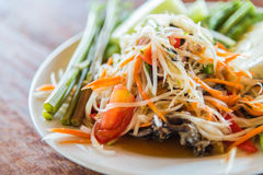 Som Tam is Thai delicious taste hot and spicy papaya salad with crab. 2 Stock Photos