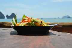 Som tam thai, green papaya salad. With an ocean background at Tonsai beach Royalty Free Stock Photography
