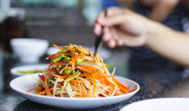 Som Tam Thai. Thai green papaya salad with peanuts Stock Photo