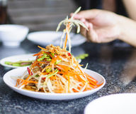 Som Tam Thai. Thai green papaya salad with peanuts Royalty Free Stock Photo