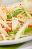 Som Tam Thai. Thai Green Papaya Salad with peanuts. Close up Royalty Free Stock Photography