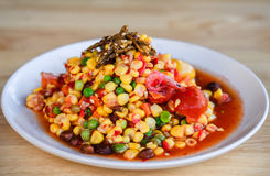 Som Tum or corn Salad, Corn Pok Pok. Thai Traditional Cuisine, Popular Thai Food. Rustic still life style Stock Image
