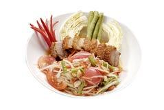 Som Tum. And crispy pork on white dish isolated on background Royalty Free Stock Photo