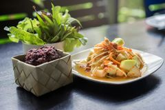 Som Tum Fruit Salad or Sour Spicy Thai fruit salad with Black Glutinous Rice in basket, Popular Thai-Eastern fusion food royalty free stock images