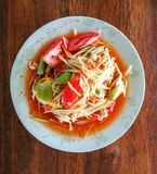 Som Tum or green papaya salad on the white dish. Thai food royalty free stock image