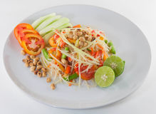 Som Tum Isan, Thai papaya salad serve with vegetables. Thai papaya salad serve with vegetables Royalty Free Stock Photography
