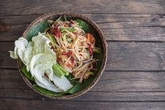 Som-Tum the most famous food in Thailand. Papaya salad is a popular trays in Thailand.spicy food call name Som-Tum on white background with clipping path royalty free stock images