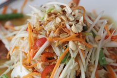 Som tum, Papaya salad, one of spicy salad from Thai eastern restaurant, prepared food. For commercial advertisment stock image