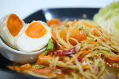 Som Tum papaya salad with salted egg. Spicy Thai food Royalty Free Stock Images