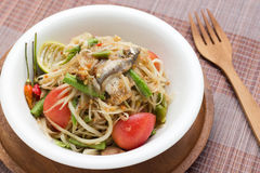 Som tum. Papaya spicy sweet and sour salad with raw crab and vegetable called Stock Photo