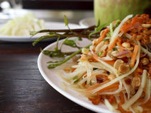 Som Tum Payaya Salad. A plate of Thai green papaya salad with dried shrimps and peanuts Stock Photo