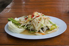 Som Tum or thai food fruit spicy green papaya salad with blue cr. Thai cuisine Som Tum or thai food fruit spicy green papaya salad with blue crab in plate stock image