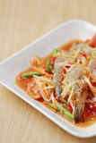 SOM TUM,Thai foods or papaya salad with fresh shrimp in spicy ta. Ste and is popular in thailand on wooden table background royalty free stock images
