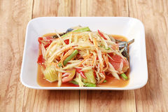 SOM TUM,Thai foods or papaya salad in spicy taste and is popular. In Thailand on wooden table background royalty free stock photo