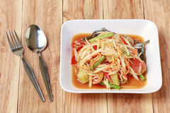SOM TUM,Thai foods or papaya salad in spicy taste and is popular. In thailand on wooden table background stock image