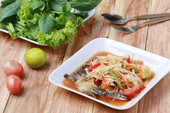 SOM TUM,Thai foods or papaya salad in spicy taste and is popular. In thailand on wooden table background Royalty Free Stock Image