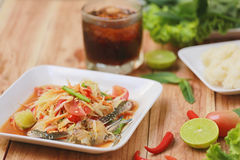 SOM TUM,Thai foods or papaya salad in spicy taste and is popular. In thailand on wooden table background royalty free stock photography