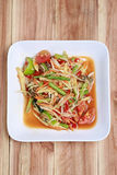 SOM TUM,Thai foods or papaya salad in spicy taste and is popular. In Thailand on wooden table background Stock Images
