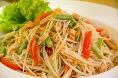 Som Tum Thai or Green Papaya Salad. Serve on styrofoam plate at P stock photos