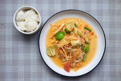 Papaya salad som tum thai on plate. Som tum Thai spicy green papaya eat couple sticky rice on plate stock photos
