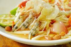 Som tum Thai spicy green papaya topping raw prawn salad on plate. Som tum Thai spicy green papaya topping raw prawn salad on white plate stock photography
