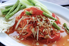 Som Tum Thai spicy papaya salad. Traditional Thai spicy papaya salad with peanuts Royalty Free Stock Image