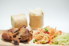 Som tum Thai with sticky rice and grilled chicken. Selective focus royalty free stock photography