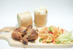 Som tum Thai with sticky rice and grilled chicken. Selective focusselective focus Stock Image
