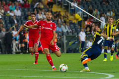 Soma Charity Tournament. ISTANBUL - AUGUST 08, 2014: Besiktas player Cenk Tosun is attacking to Fenerbahce in Soma Charity Tournament in Sukru Saracoglu Stadium Royalty Free Stock Images