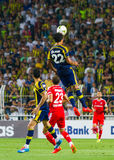 Soma Charity Tournament. ISTANBUL - AUGUST 08, 2014: Bruno Alves jump for ball during Fenerbahce vs Besiktas match in Soma Charity Tournament in Sukru Saracoglu Stock Image