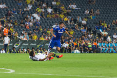 Soma Charity Tournament. ISTANBUL - AUGUST 08, 2014: Chelsea is attacking to Fenerbahce in Soma Charity Tournament in Sukru Saracoglu Stadium Royalty Free Stock Photo
