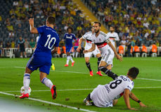Soma Charity Tournament. ISTANBUL - AUGUST 08, 2014: Chelsea player Eden Hazard is attacking to Besiktas in Soma Charity Tournament in Sukru Saracoglu Stadium Royalty Free Stock Image