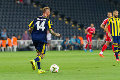 Soma Charity Tournament. ISTANBUL - AUGUST 08, 2014: Raul Meireles play with ball during Fenerbahce vs Besiktas match in Soma Charity Tournament in Sukru Royalty Free Stock Photo