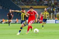 Soma Charity Tournament. ISTANBUL - AUGUST 08, 2014: Ugur Boral is attacking to Fenerbahce in Soma Charity Tournament in Sukru Saracoglu Stadium Royalty Free Stock Photos