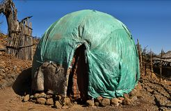 Somali Issa Huts in Djibouti, East Africa. Somali Issa Huts constructed with branches and fibre mats covered with plastic wraps in a village in northern Djibouti Royalty Free Stock Photography