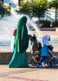 Somali Mother. A Somali mother walks in the park with her children Stock Photo