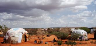 Somali village, Ogaden, Ethiopia. Huts patched with all sorts of material are the basic parts of these huts in a Somali settlement in Ogaden, Ethiopia stock photography