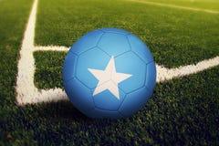Somalia ball on corner kick position, soccer field background. National football theme on green grass.  vector illustration