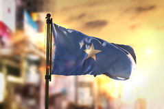 Somalia Flag Against City Blurred Background At Sunrise Backligh. T Sky Royalty Free Stock Photography