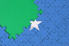 Somalia flag is depicted on a completed jigsaw puzzle with free green copy space on the left side.  stock photography
