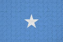 Somalia flag is depicted on a folded puzzle stock image