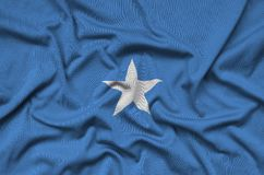 Somalia flag is depicted on a sports cloth fabric with many folds. Sport team banner. Somalia flag is depicted on a sports cloth fabric with many folds. Sport stock images