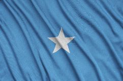 Somalia flag is depicted on a sports cloth fabric with many folds. Sport team banner. Somalia flag is depicted on a sports cloth fabric with many folds. Sport vector illustration