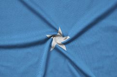 Somalia flag is depicted on a sports cloth fabric with many folds. Sport team banner. Somalia flag is depicted on a sports cloth fabric with many folds. Sport stock image