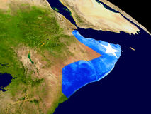 Somalia with flag on Earth Royalty Free Stock Images