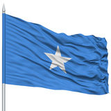 Somalia Flag on Flagpole. Flying in the Wind, Isolated on White Background Royalty Free Stock Photography