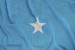 Somalia flag printed on a polyester nylon sportswear mesh fabric. With some folds royalty free stock photography