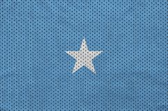 Somalia flag printed on a polyester nylon sportswear mesh fabric. With some folds royalty free stock photos
