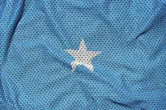 Somalia flag printed on a polyester nylon sportswear mesh fabric. With some folds stock photos